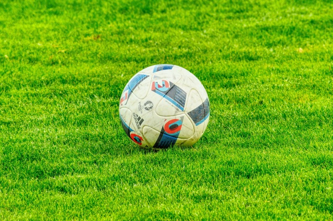 A soccer ball in the field.