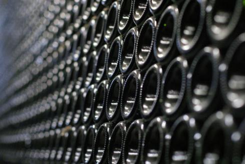 Bottles of wine stacked together
